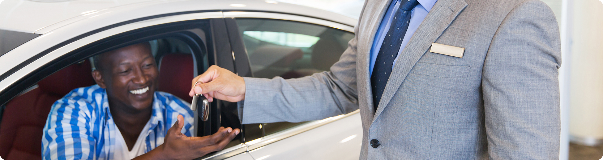 Man Sitting In New Car Receives Car Keys