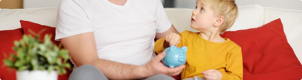 dad teaching son about financial literacy